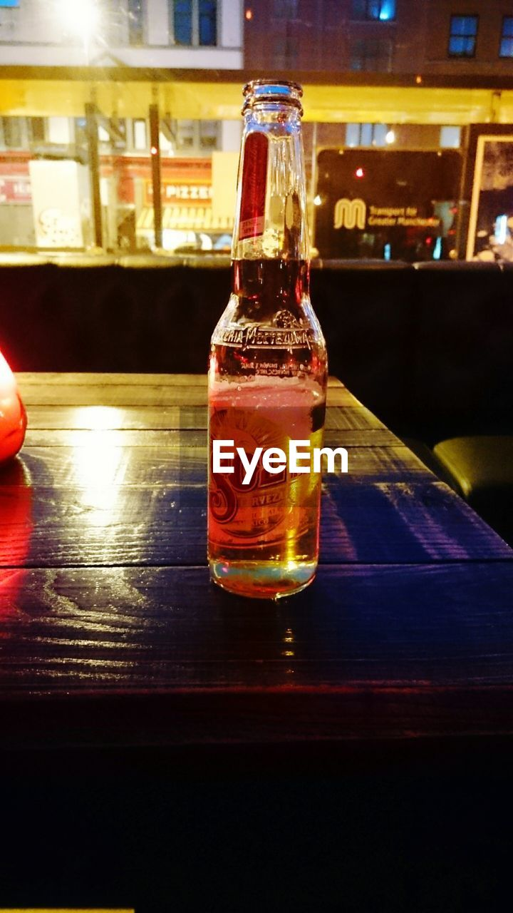 bottle, table, indoors, food and drink, refreshment, drink, alcohol, close-up, drinking glass, freshness, no people, night