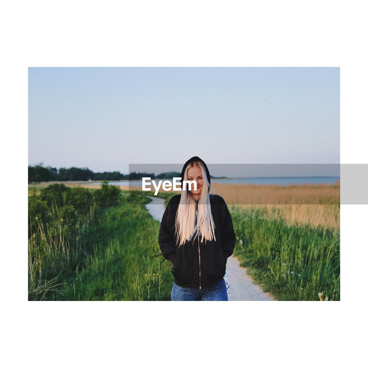 real people, one person, leisure activity, sky, landscape, portrait, lifestyles, land, looking at camera, field, nature, grass, environment, plant, auto post production filter, young adult, standing, front view, scenics - nature, outdoors, hairstyle