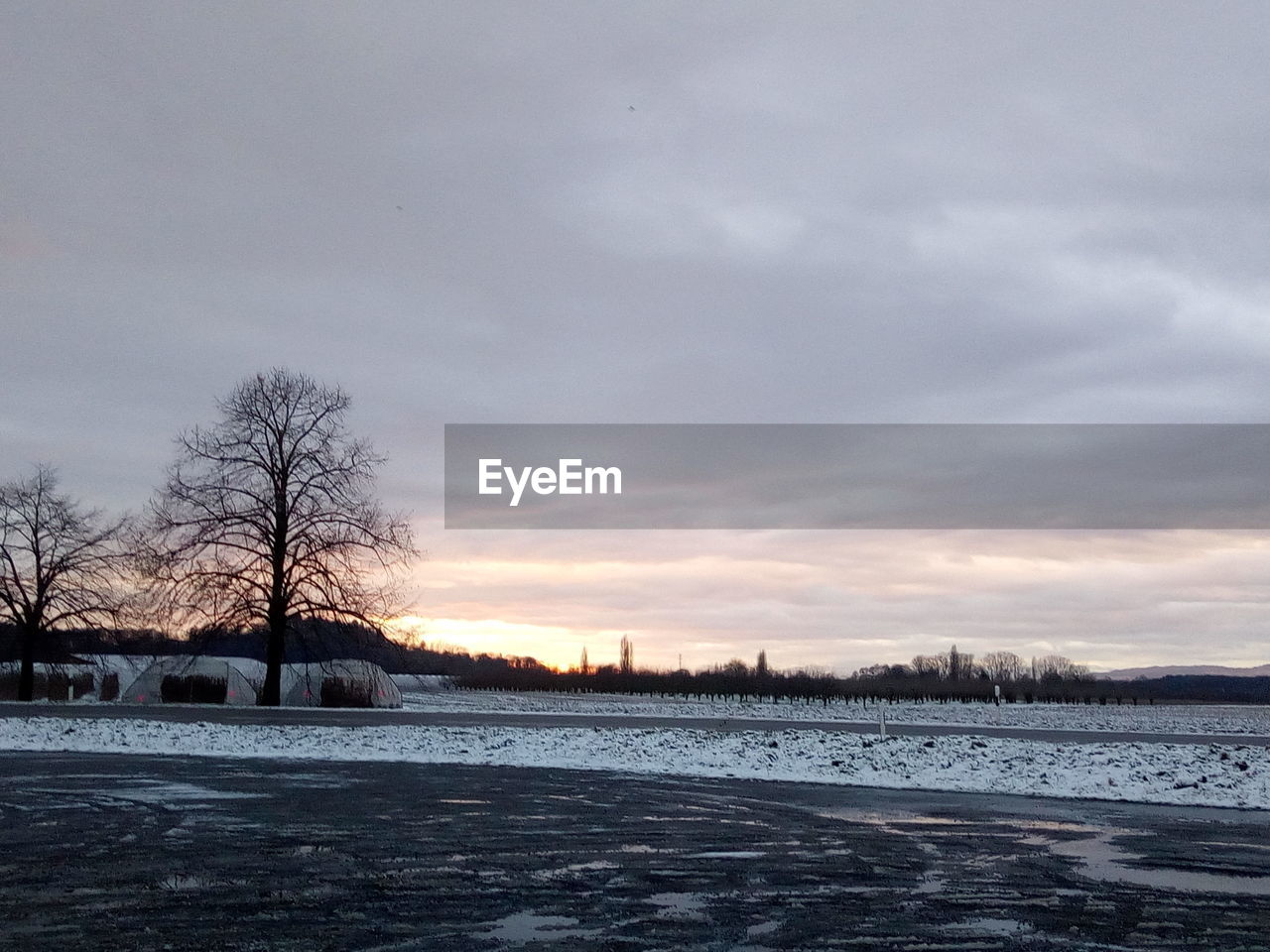 cold temperature, winter, snow, weather, frozen, bare tree, nature, cold, ice, beauty in nature, sky, tranquility, landscape, scenics, tranquil scene, outdoors, frost, tree, no people, extreme weather, cloud - sky, flat, frozen water, sunset, day, snowdrift, bleak