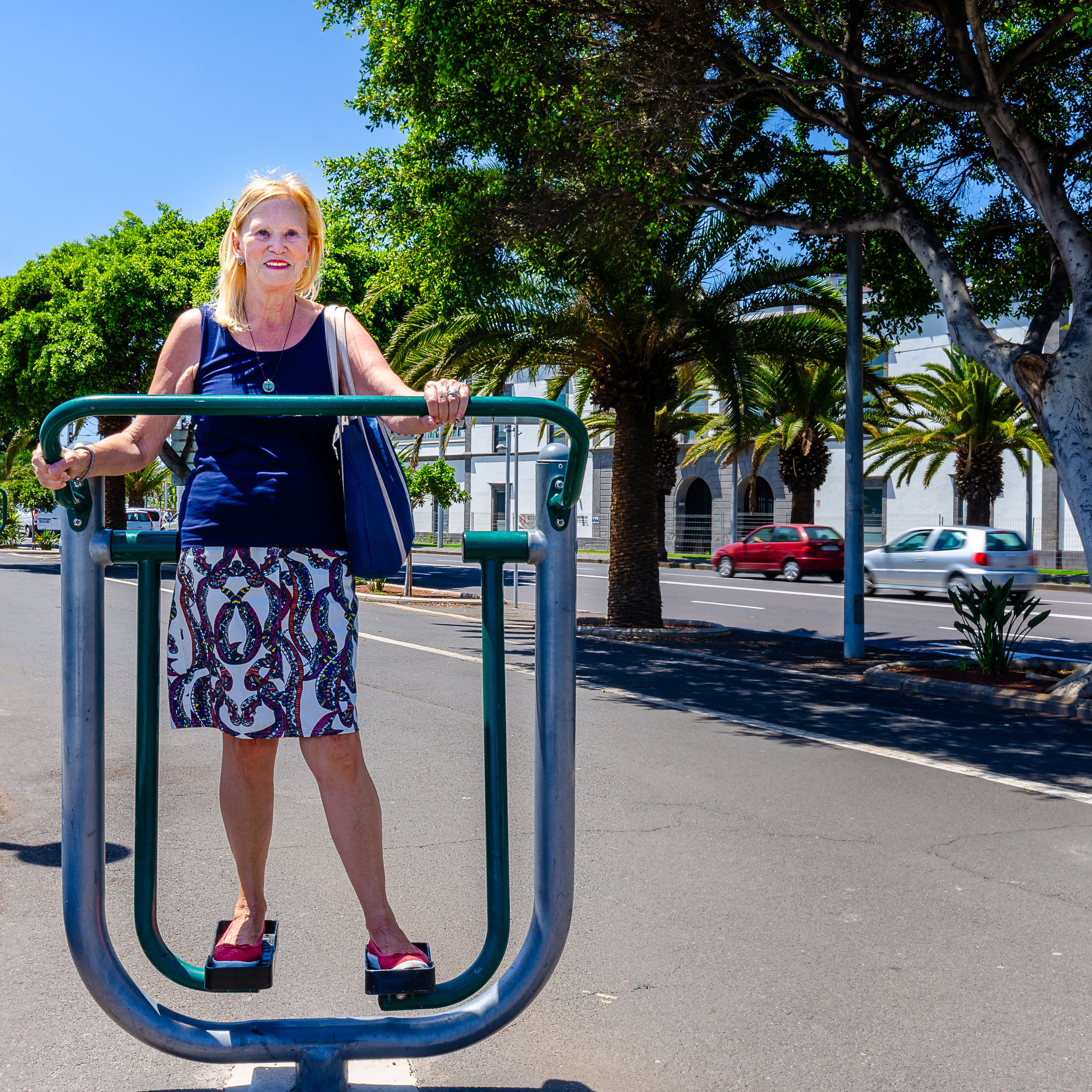 Portrait of woman standing on exercise equipment