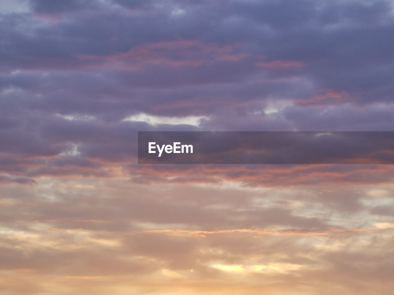 cloud - sky, beauty in nature, nature, sunset, sky, scenics, tranquility, cloudscape, majestic, dramatic sky, tranquil scene, sky only, backgrounds, atmospheric mood, orange color, no people, heaven, outdoors, idyllic, low angle view, full frame, awe, day