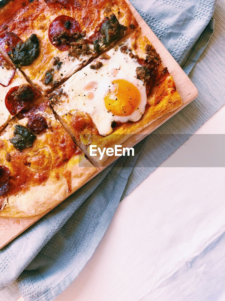 food, food and drink, pizza, ready-to-eat, still life, table, freshness, indoors, unhealthy eating, high angle view, no people, italian food, meal, close-up, egg, indulgence, wood - material, dairy product, fried egg, breakfast, snack, temptation