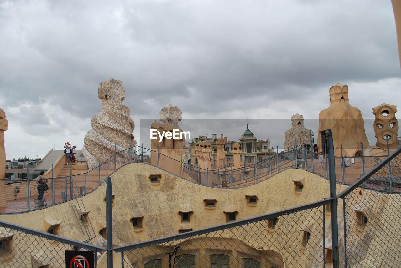 cloud - sky, sky, architecture, built structure, statue, sculpture, history, travel destinations, building exterior, low angle view, outdoors, day, no people, city, ancient civilization