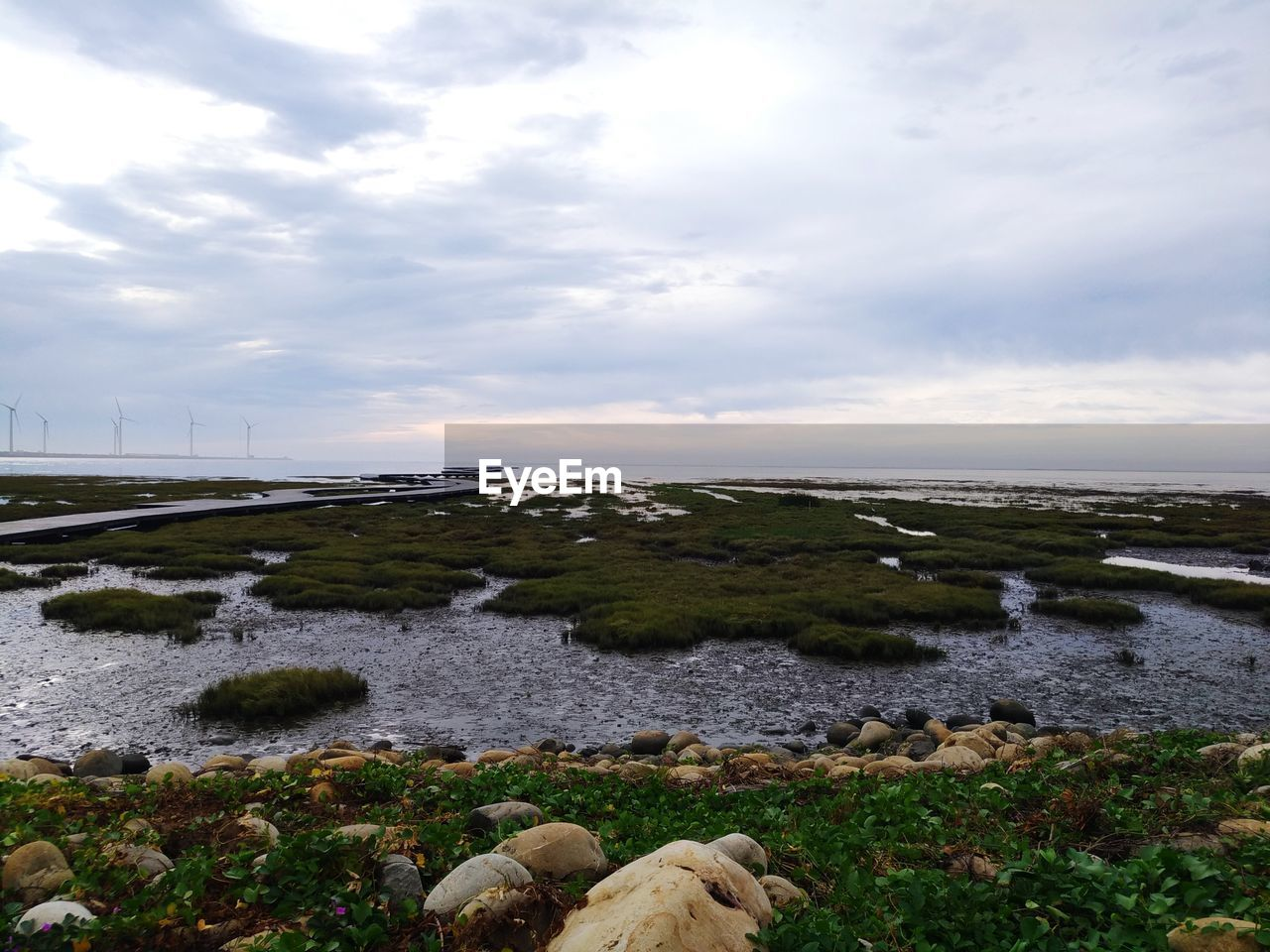 sky, water, cloud - sky, scenics - nature, beauty in nature, nature, tranquil scene, land, tranquility, rock, plant, solid, sea, no people, non-urban scene, day, rock - object, beach, horizon, outdoors