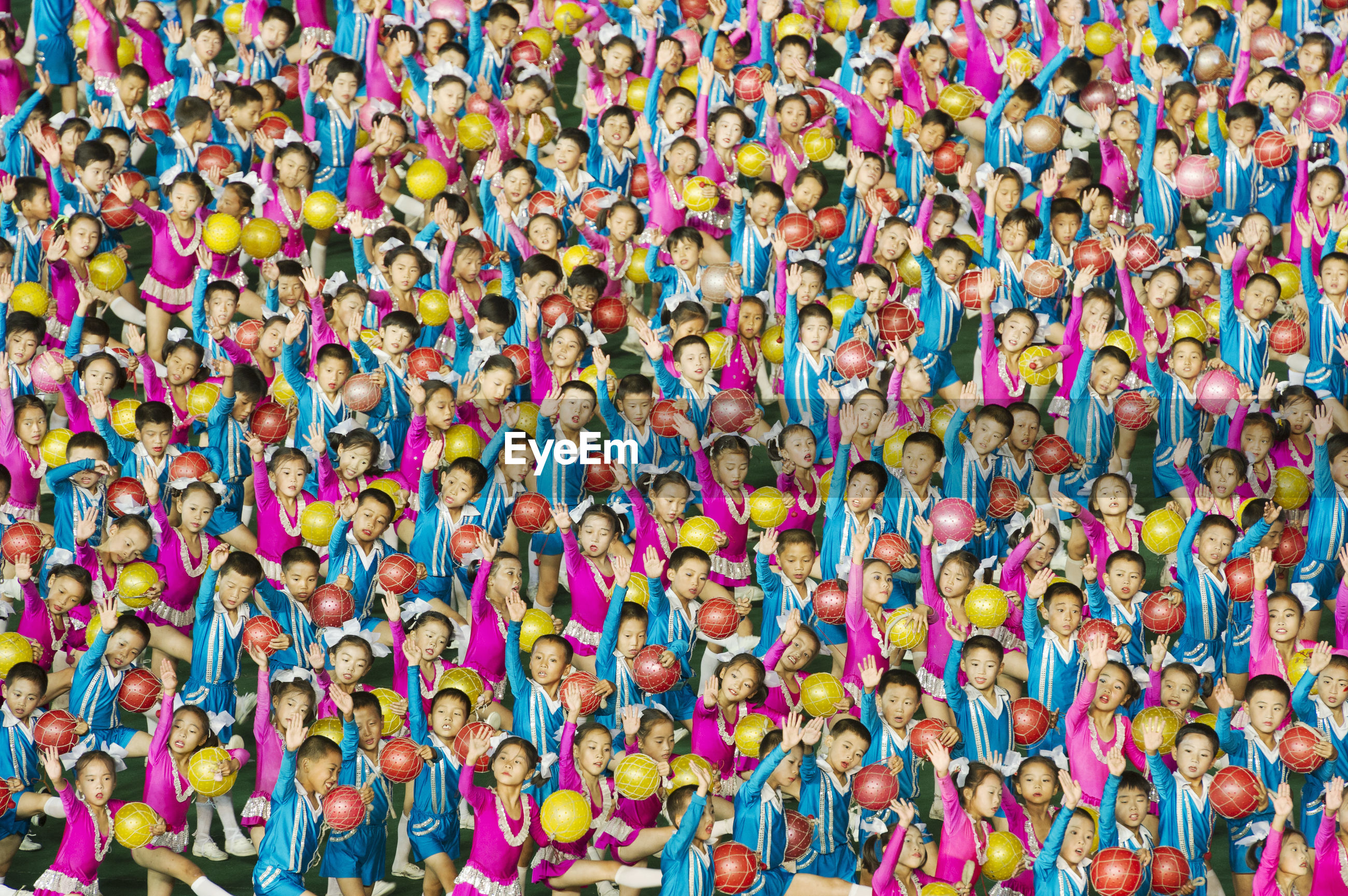 HIGH ANGLE VIEW OF PEOPLE ON COLORFUL WALL