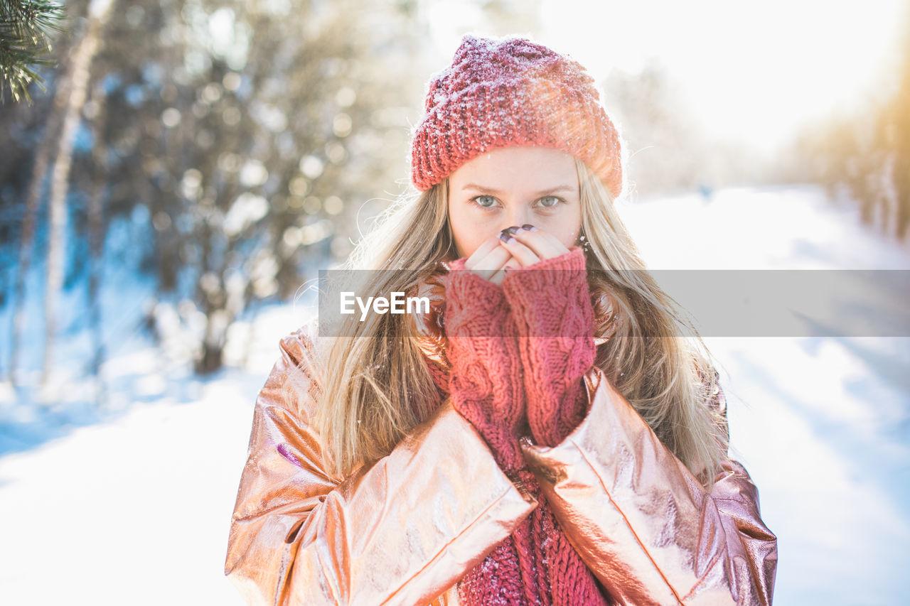 Portrait Of Woman Against Trees On Snowy Field