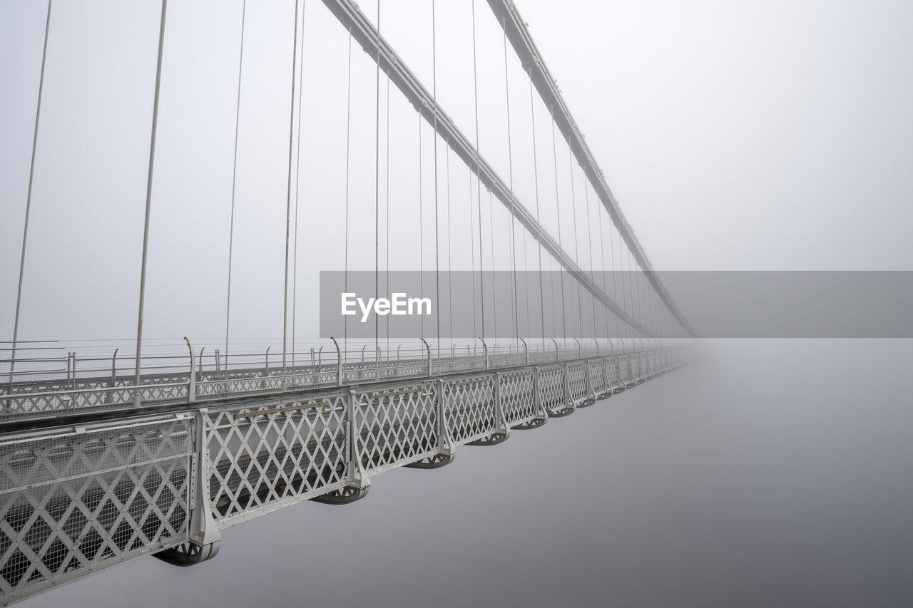 Suspension Bridge In Foggy Weather