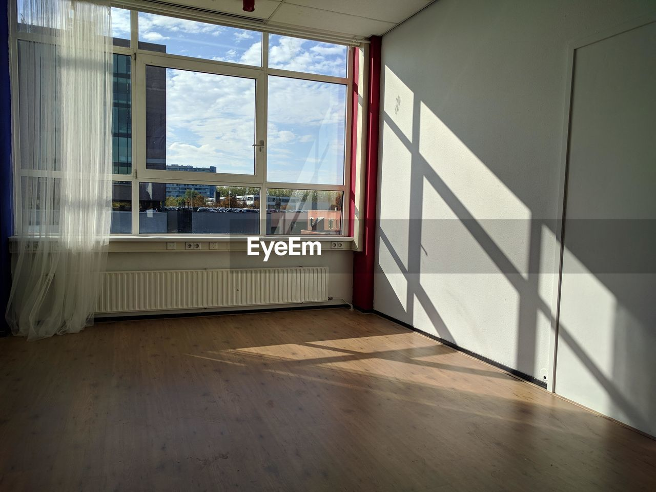 window, indoors, hardwood floor, flooring, wood, glass - material, home interior, day, empty, architecture, transparent, absence, built structure, no people, nature, domestic room, seat, sunlight, building