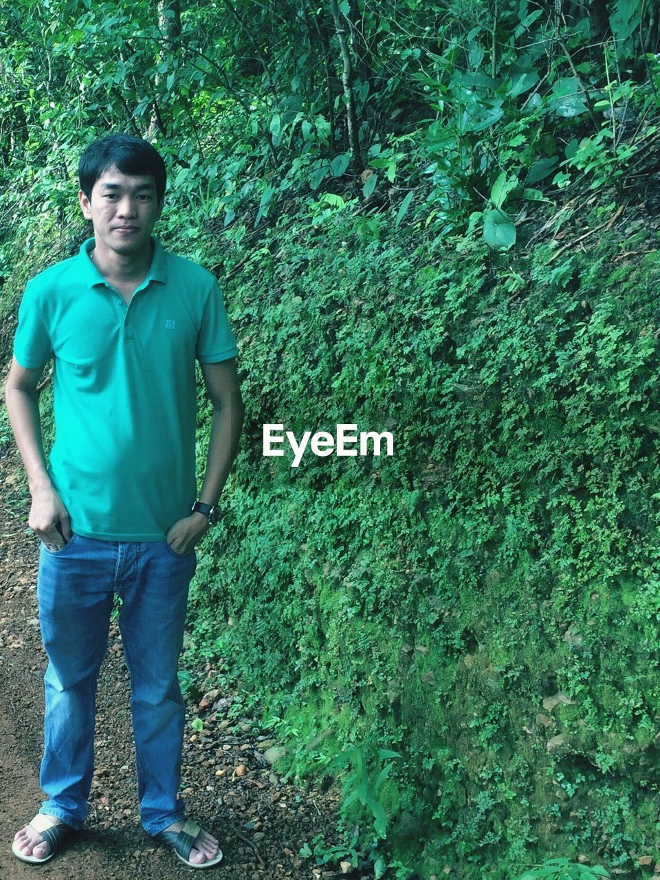 standing, casual clothing, front view, green color, one person, real people, young men, portrait, outdoors, full length, day, looking at camera, young adult, smiling, men, nature, tree, people
