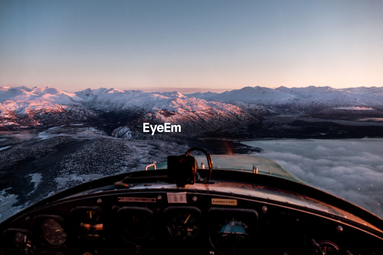 mountain, snow, winter, cold temperature, mode of transportation, sky, transportation, scenics - nature, car, beauty in nature, nature, snowcapped mountain, motor vehicle, land vehicle, mountain range, travel, environment, no people, non-urban scene, outdoors, road trip