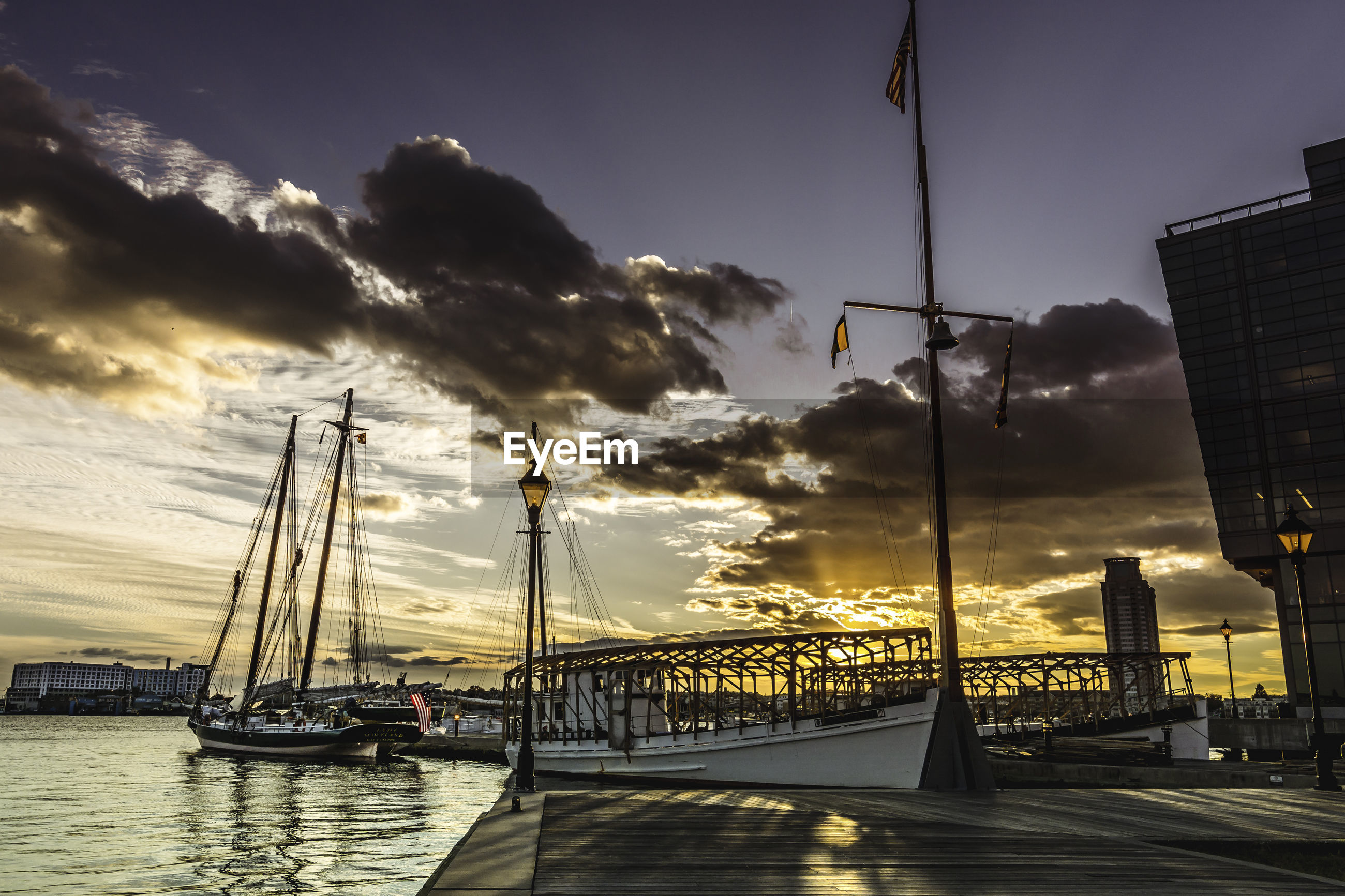sky, cloud - sky, sunset, transportation, travel destinations, outdoors, city, nautical vessel, architecture, mode of transport, no people, built structure, water, sunlight, nature, street light, building exterior, scenics, mast, beauty in nature, day