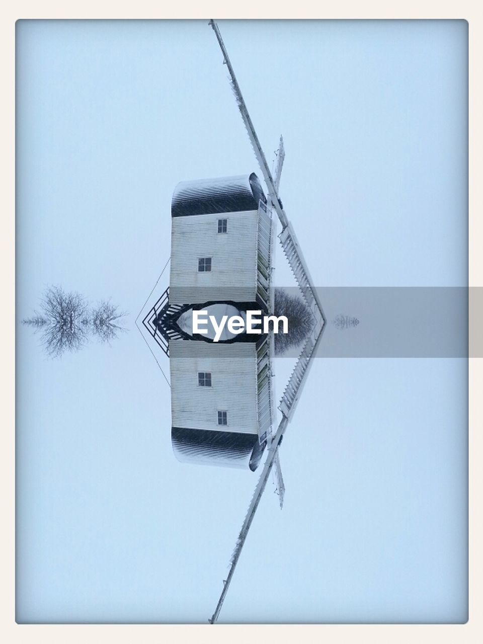 clear sky, low angle view, day, no people, windmill, wind power, outdoors, wind turbine, close-up, architecture, sky, nature, clock