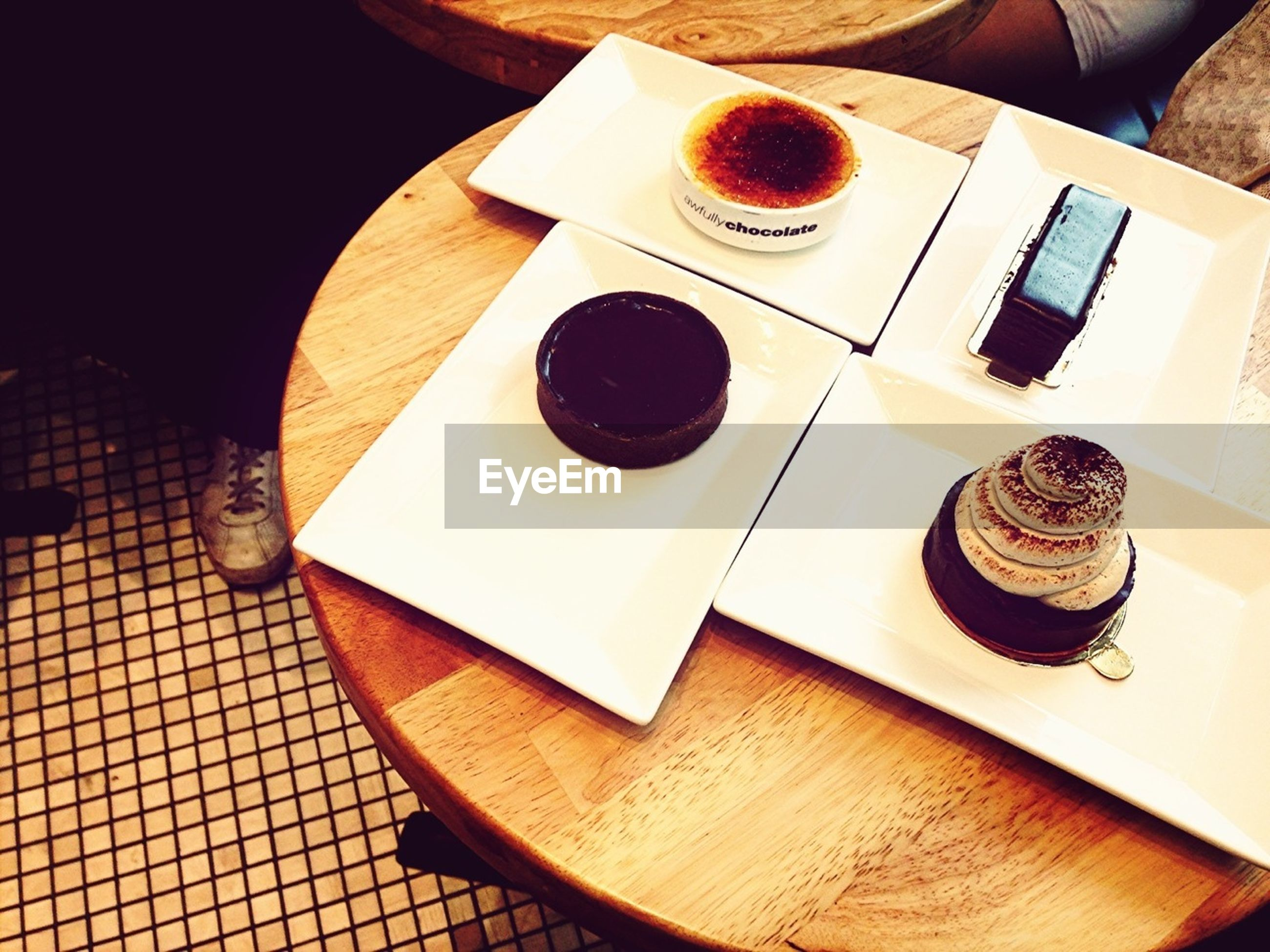 table, food and drink, indoors, drink, coffee cup, still life, refreshment, coffee - drink, high angle view, freshness, plate, food, saucer, cup, coffee, spoon, wood - material, fork, breakfast, no people