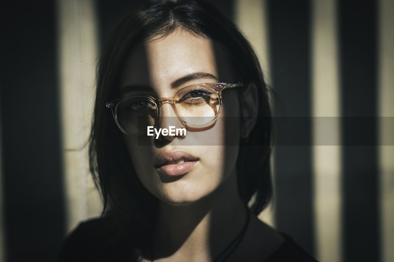 Close-Up Portrait Of Young Woman Wearing Eyeglasses