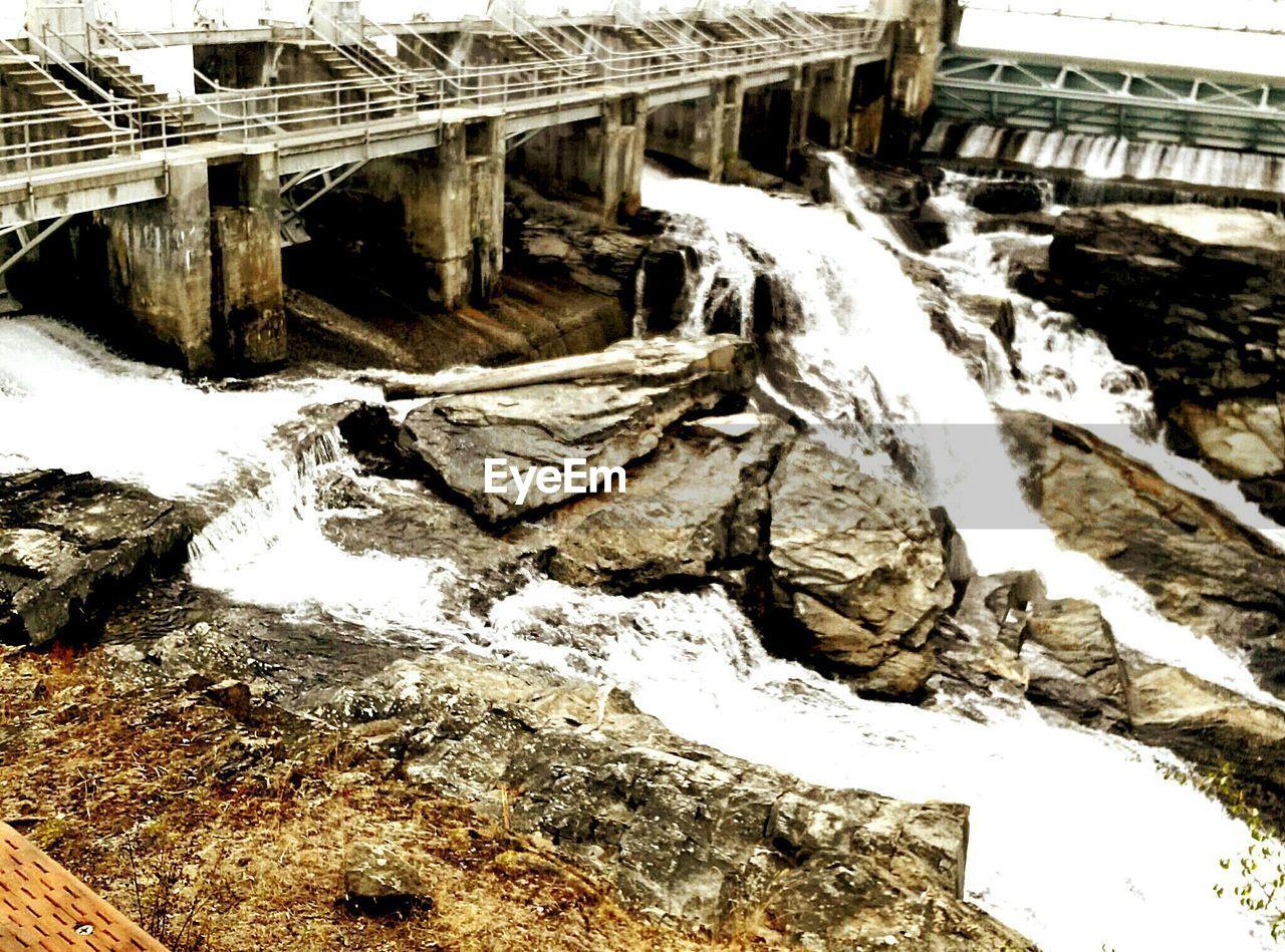 Water rushing through water dam exhausts
