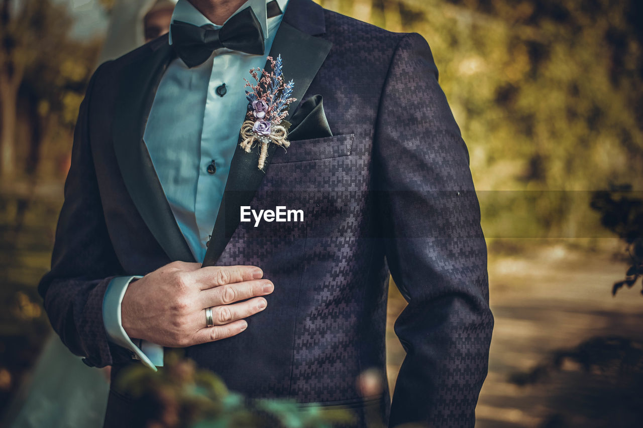 Midsection Of Bridegroom Wearing Suit During Wedding