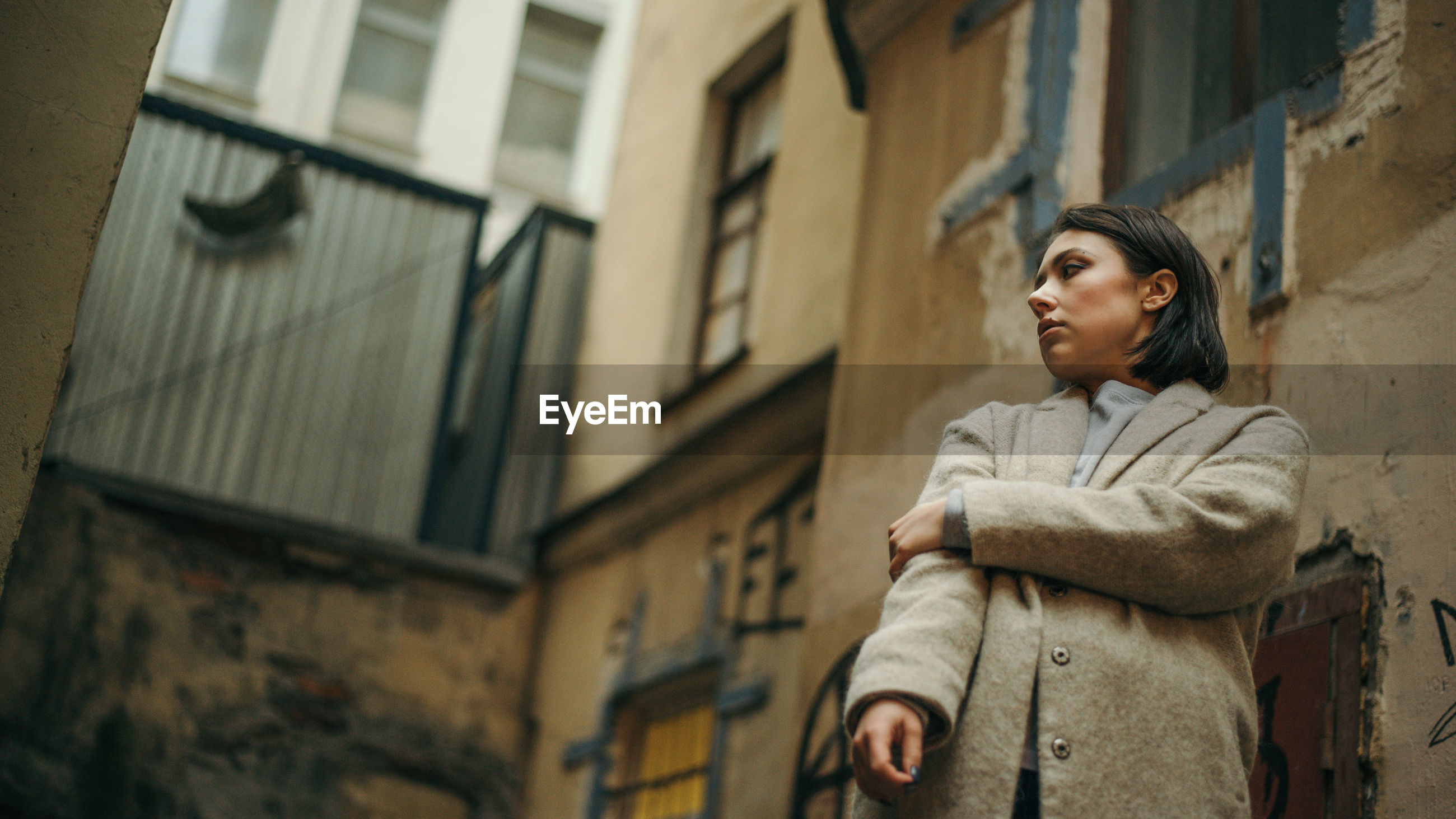 Portrait of young woman in city