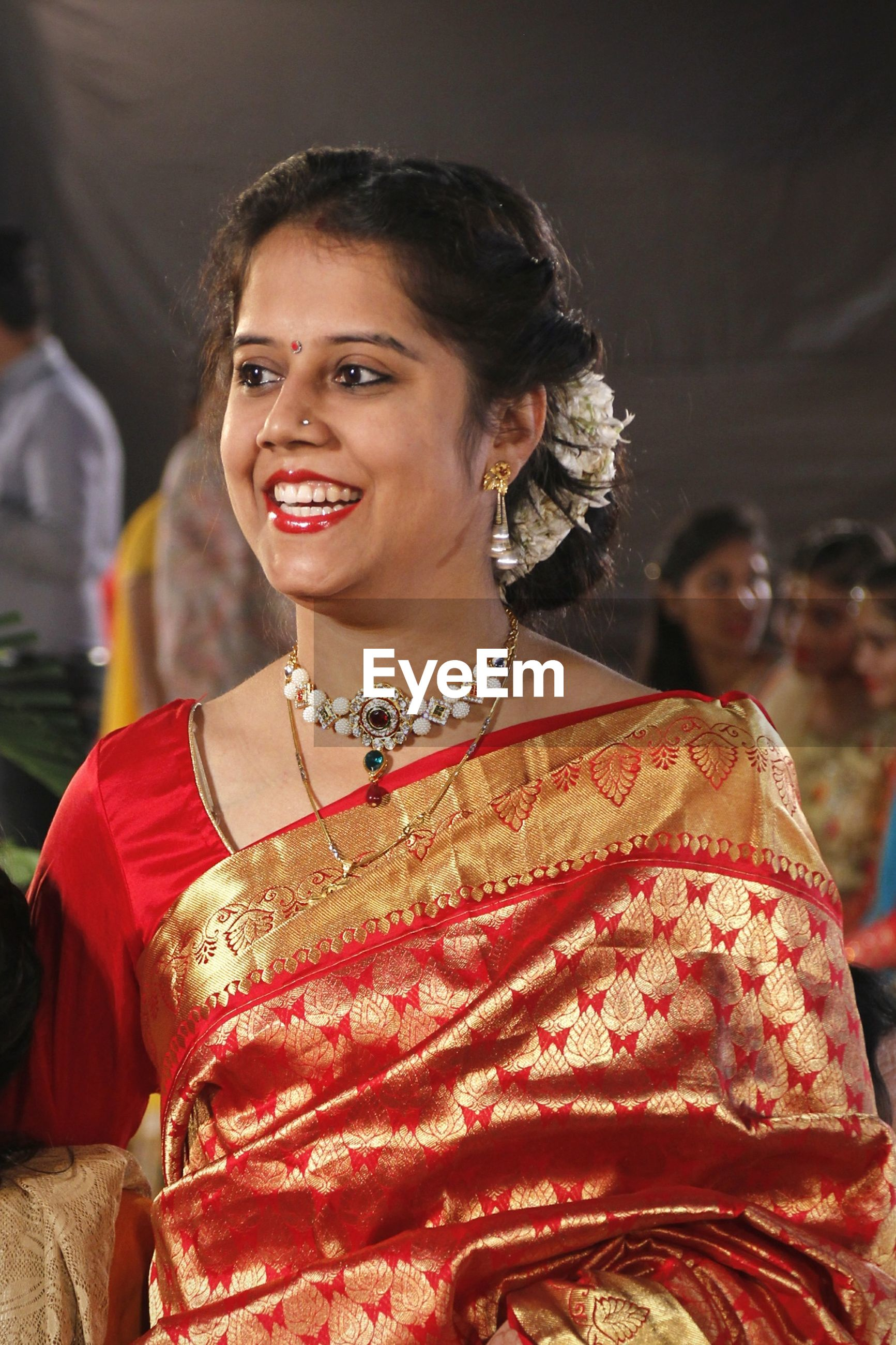 Smiling beautiful woman wearing sari during event