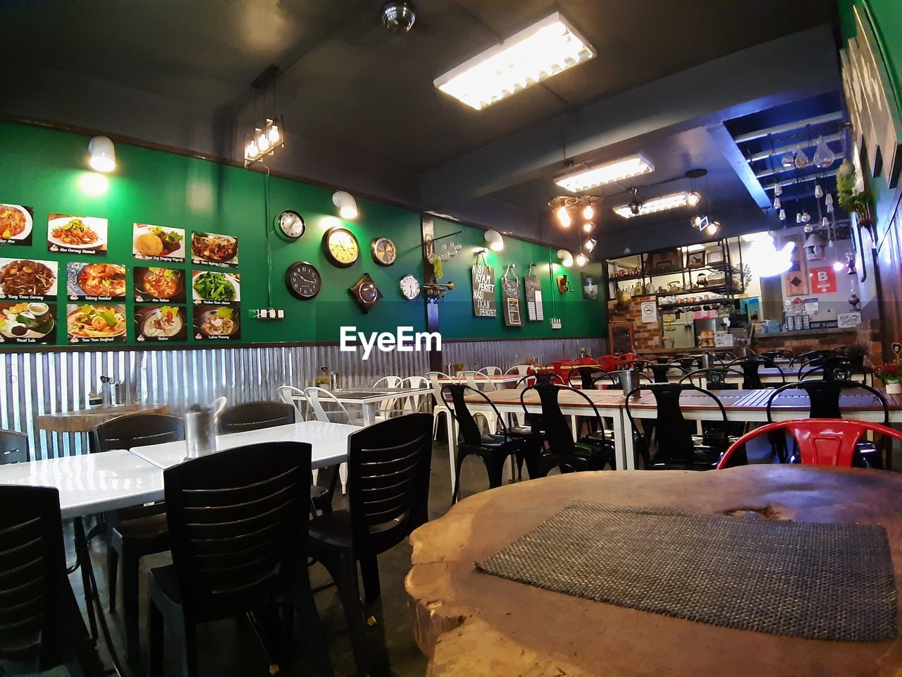 seat, chair, restaurant, illuminated, indoors, business, absence, food and drink, lighting equipment, empty, bar - drink establishment, table, large group of objects, no people, bar counter, in a row, cafe, ceiling, order, drink, setting