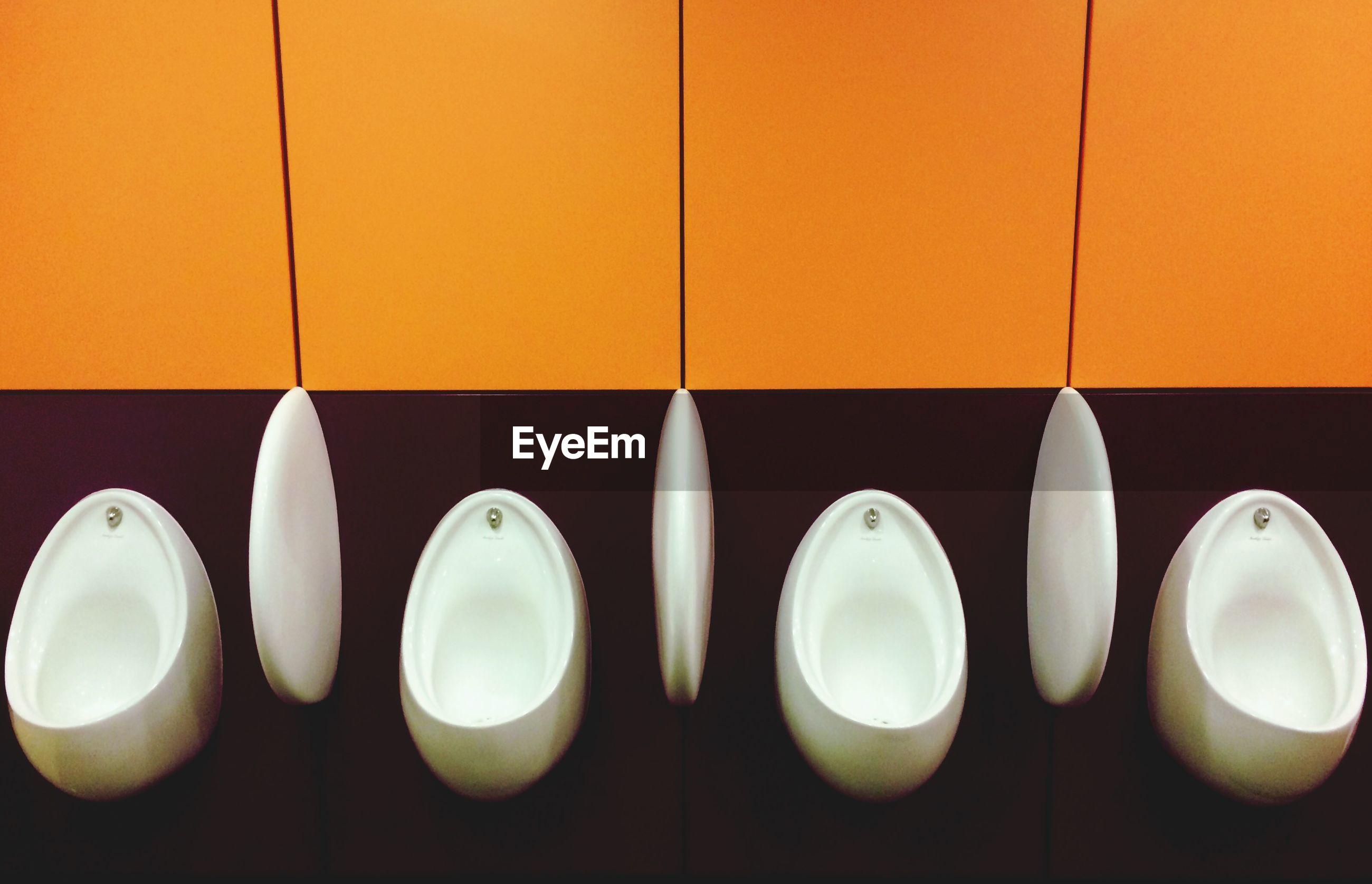 Four public urinals