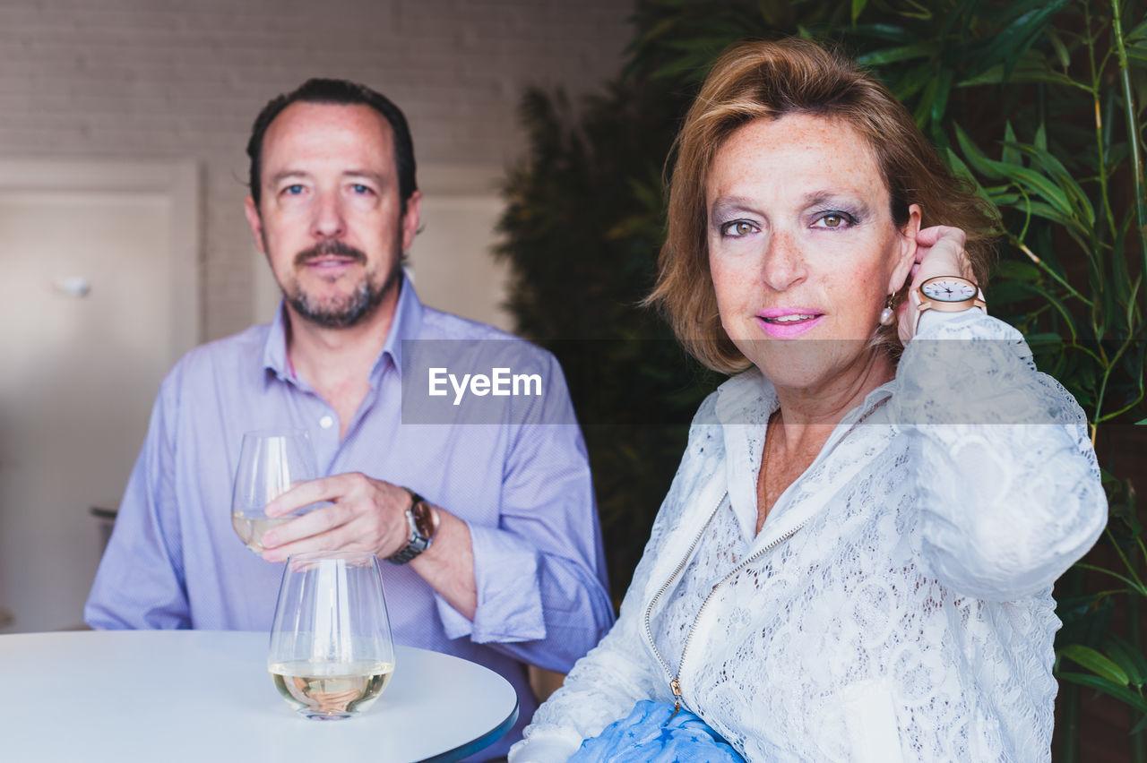 Portrait Of Couple Having Wine In Restaurant
