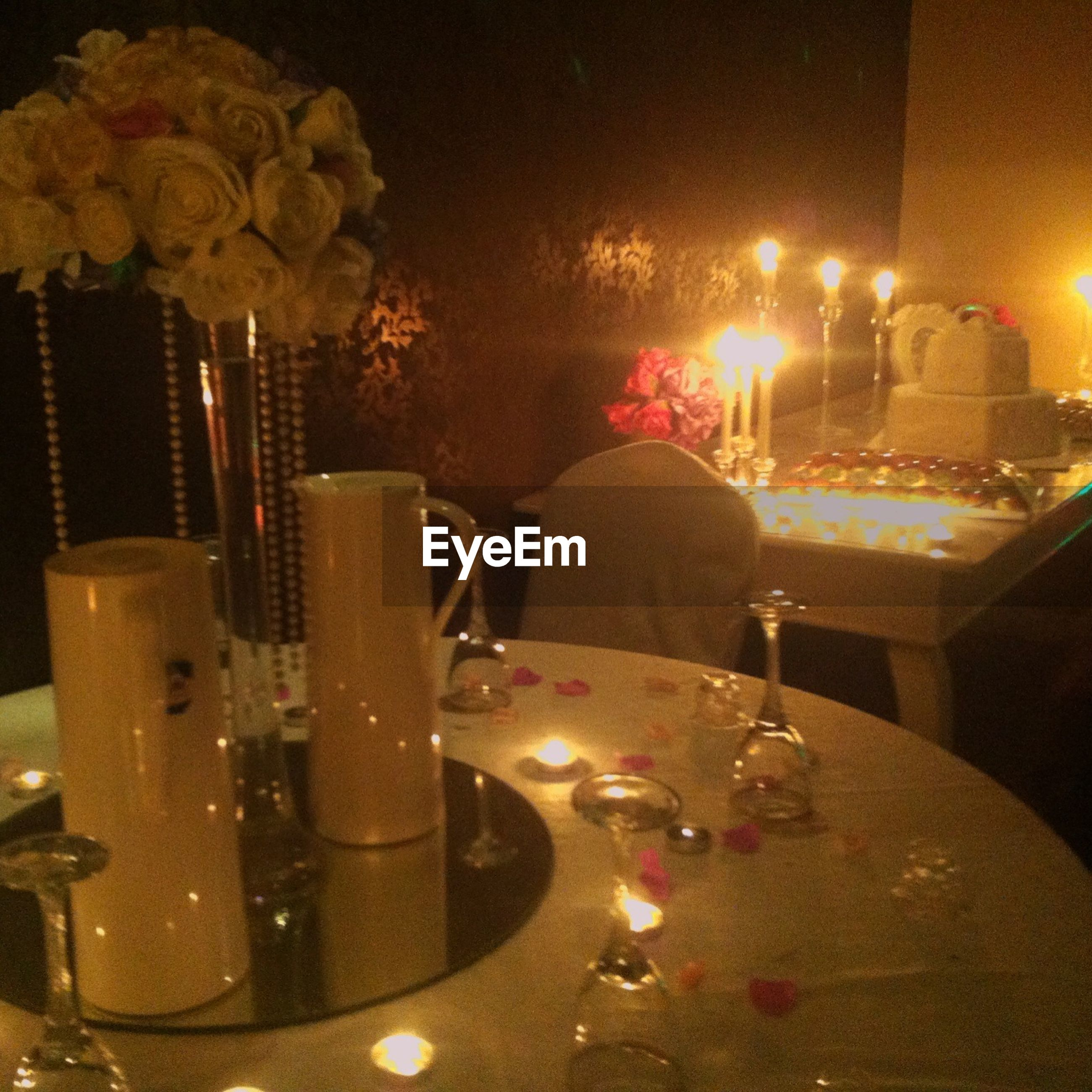 illuminated, indoors, night, burning, fire - natural phenomenon, flame, heat - temperature, glowing, candle, table, arts culture and entertainment, light - natural phenomenon, home interior, sitting, men, lighting equipment, food and drink, preparation