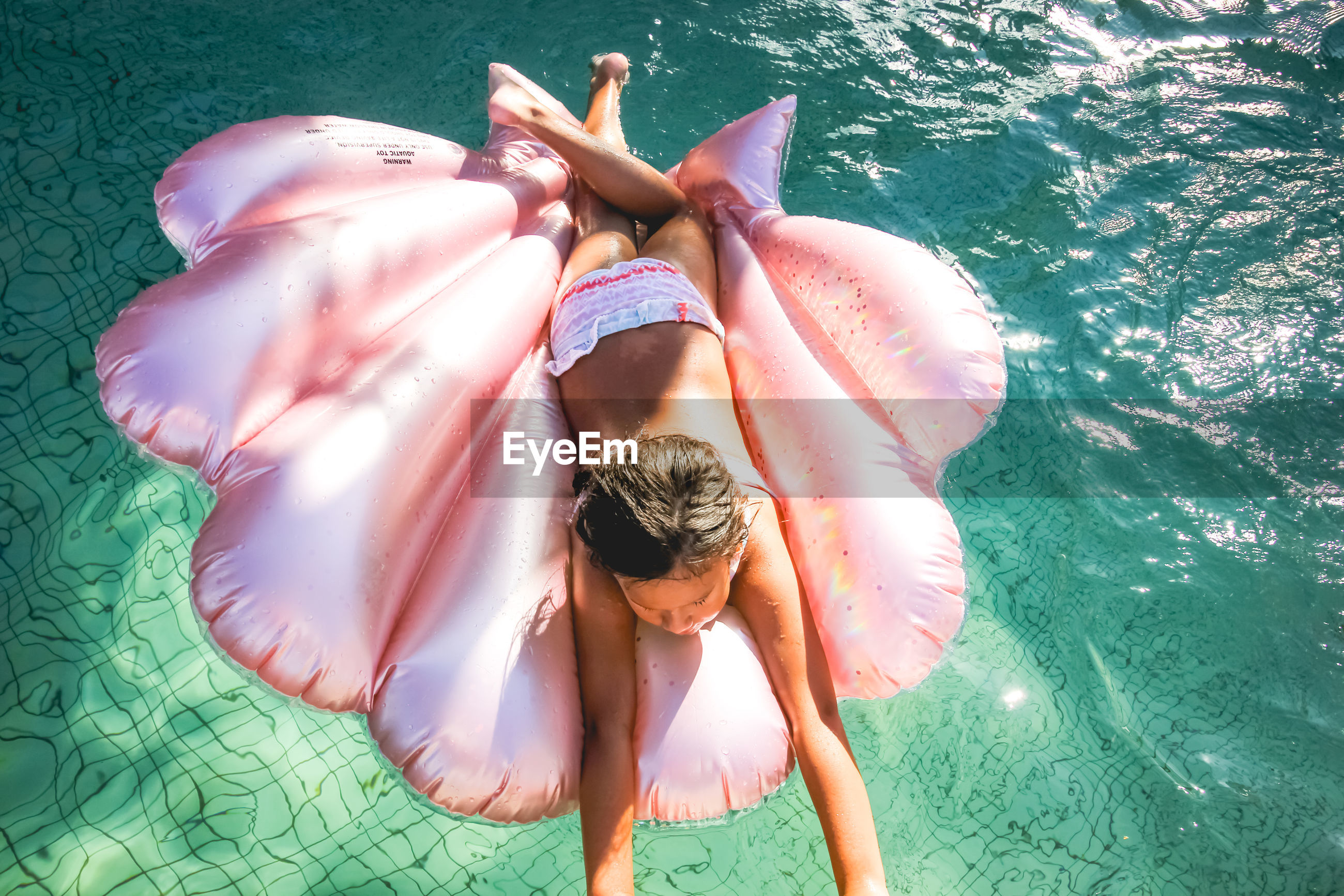 HIGH ANGLE VIEW OF GIRL WITH SWIMMING POOL