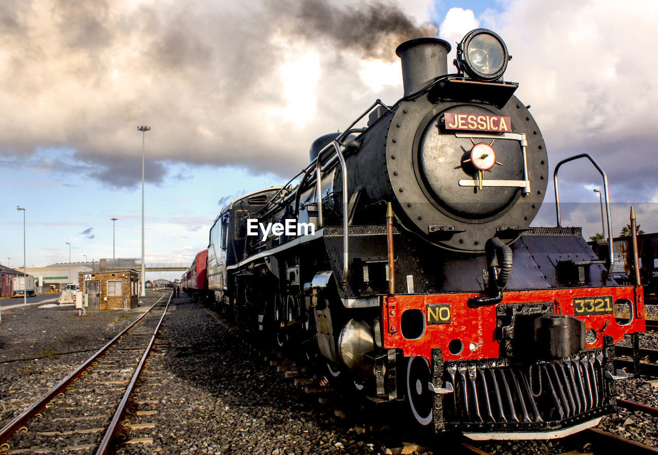 rail transportation, track, railroad track, transportation, train - vehicle, cloud - sky, mode of transportation, train, sky, public transportation, nature, locomotive, steam train, day, no people, outdoors, land vehicle, retro styled, number, shunting yard