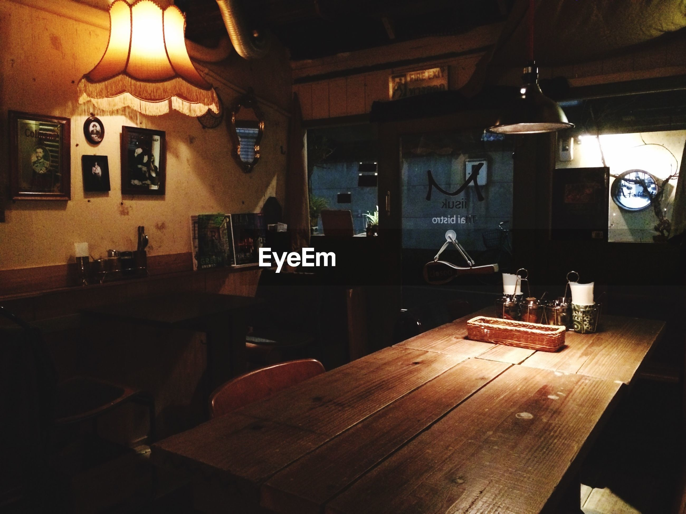 indoors, illuminated, chair, table, lighting equipment, home interior, absence, empty, built structure, architecture, interior, electric lamp, room, furniture, wood - material, house, no people, window, restaurant, night