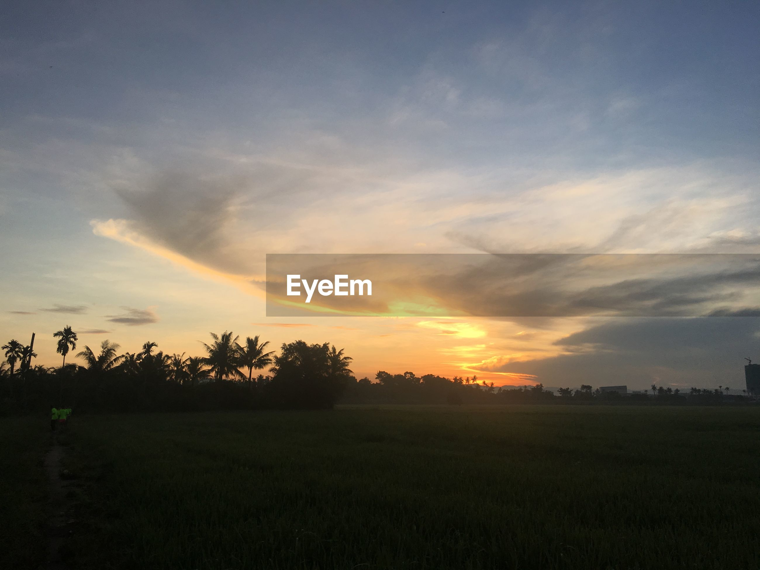 SCENIC VIEW OF LANDSCAPE AGAINST SUNSET SKY