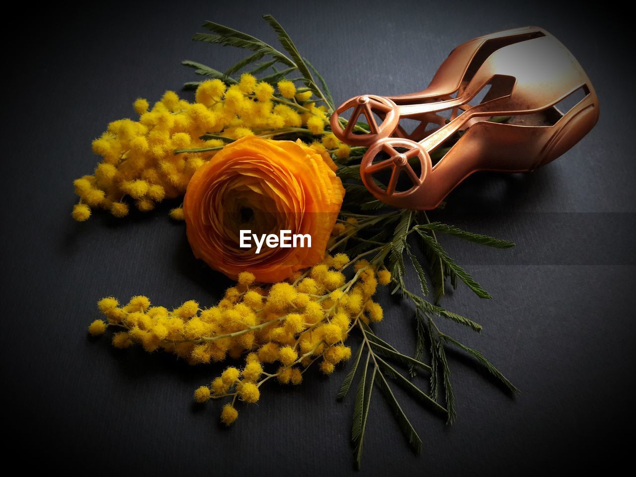 flower, plant, table, indoors, flowering plant, close-up, yellow, freshness, still life, nature, beauty in nature, art and craft, petal, no people, high angle view, craft, flower head, orange color, creativity, vulnerability