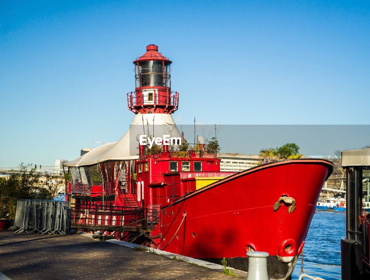 red, clear sky, built structure, no people, architecture, outdoors, transportation, day, mode of transport, building exterior, blue, nautical vessel, sky