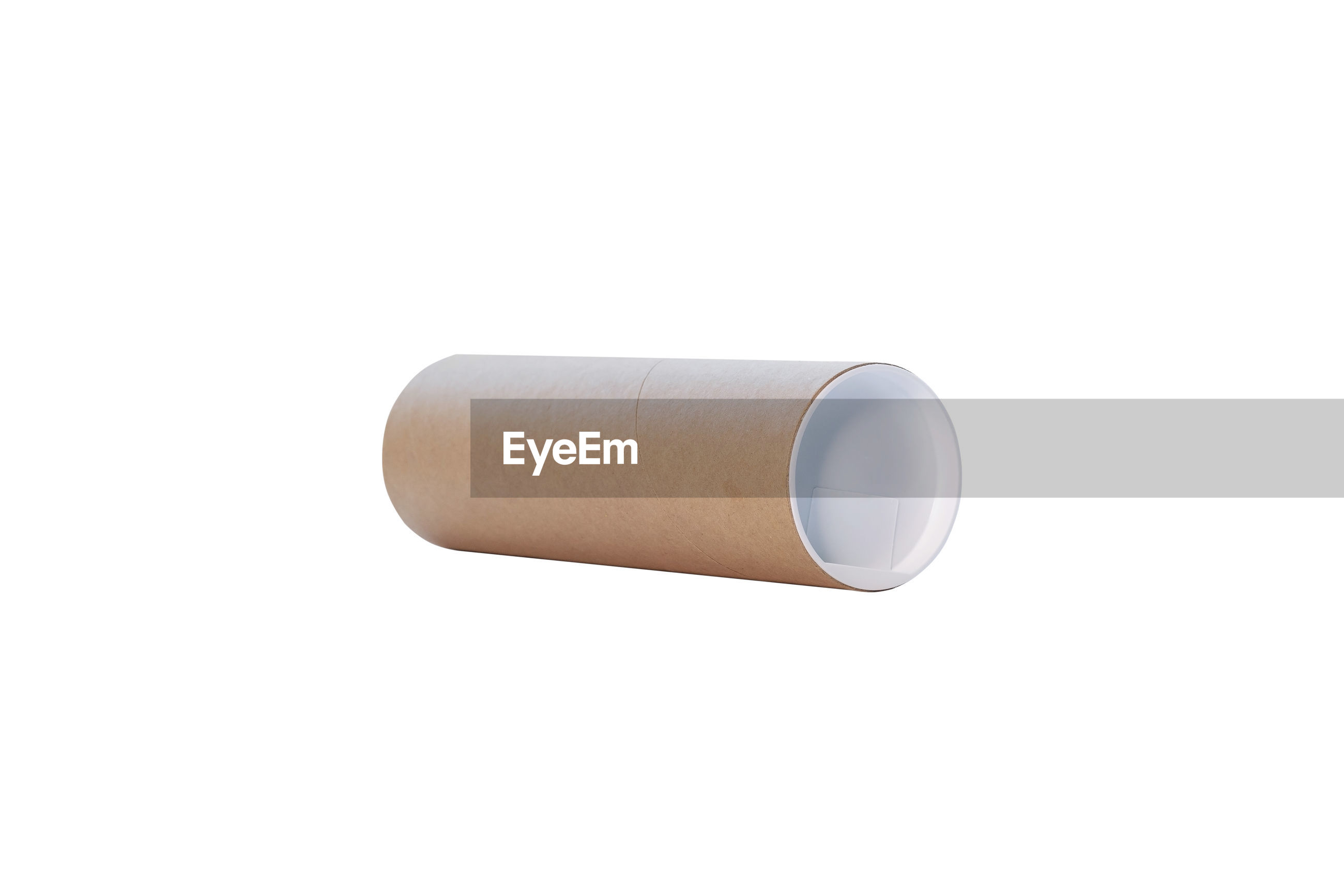 Close-up of cardboard roll on white background