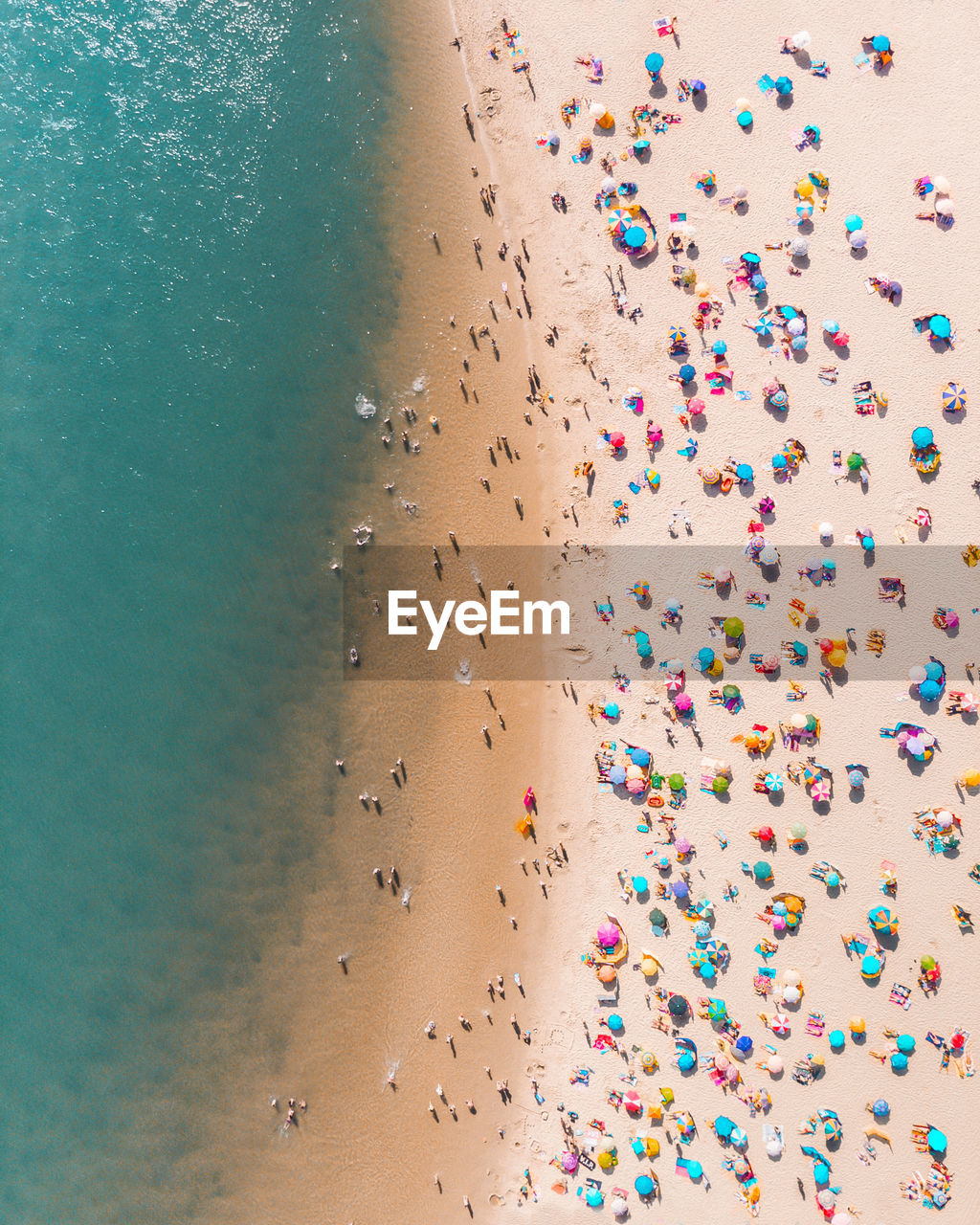Drone Shot Of Colorful Parasols And People At Beach During Summer
