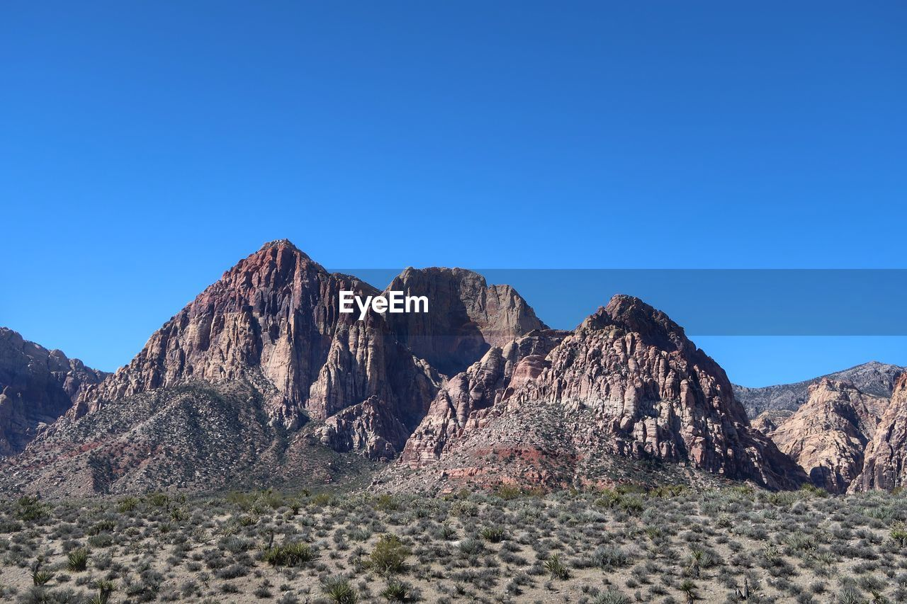 SCENIC VIEW OF MOUNTAIN AGAINST CLEAR BLUE SKY