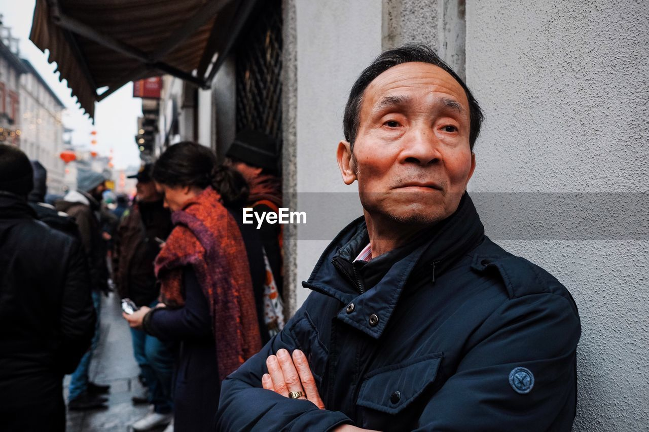 real people, portrait, looking at camera, people, lifestyles, adult, building exterior, men, architecture, incidental people, built structure, males, city, senior adult, women, mature adult, mature men, front view, standing, warm clothing