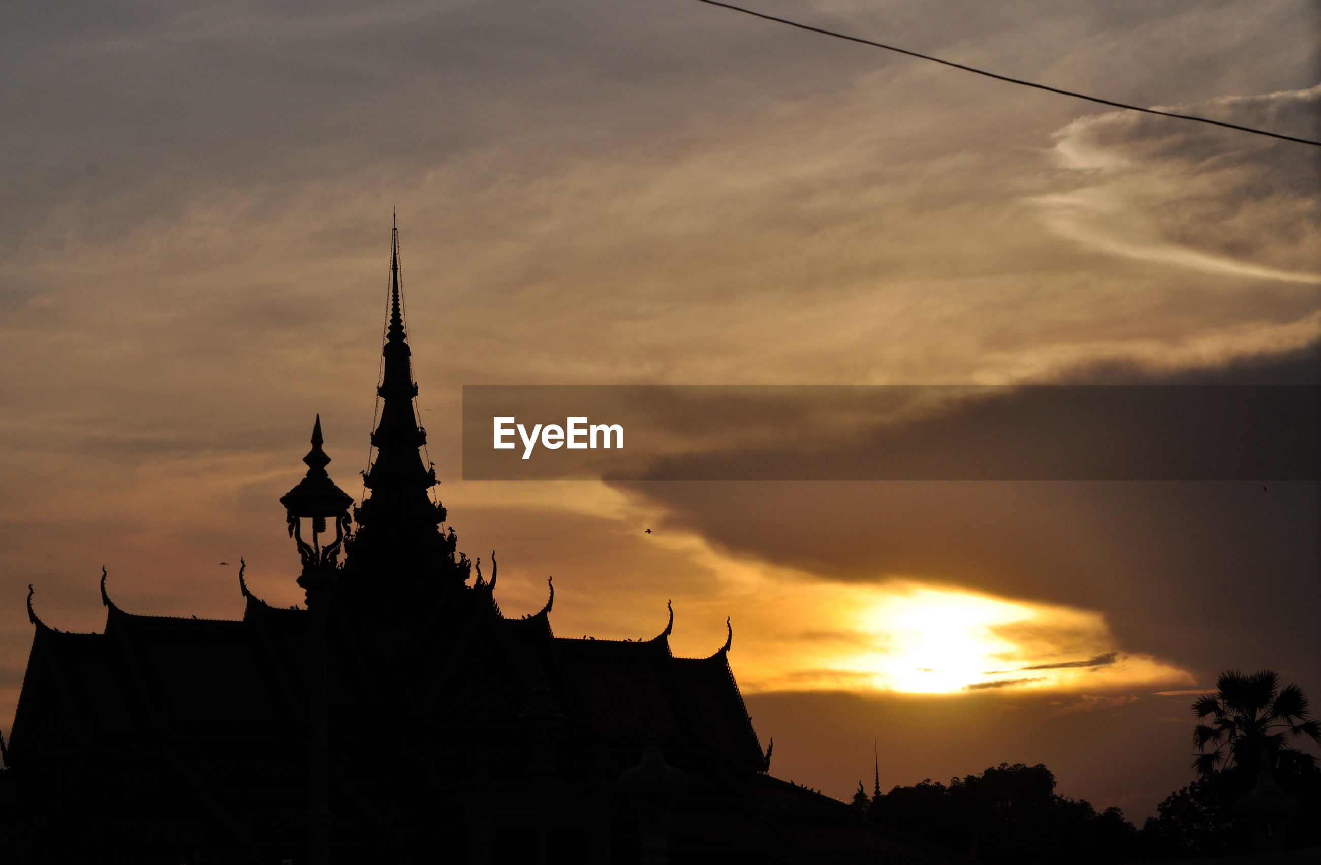 Low angle view of silhouette temple against sky during sunset