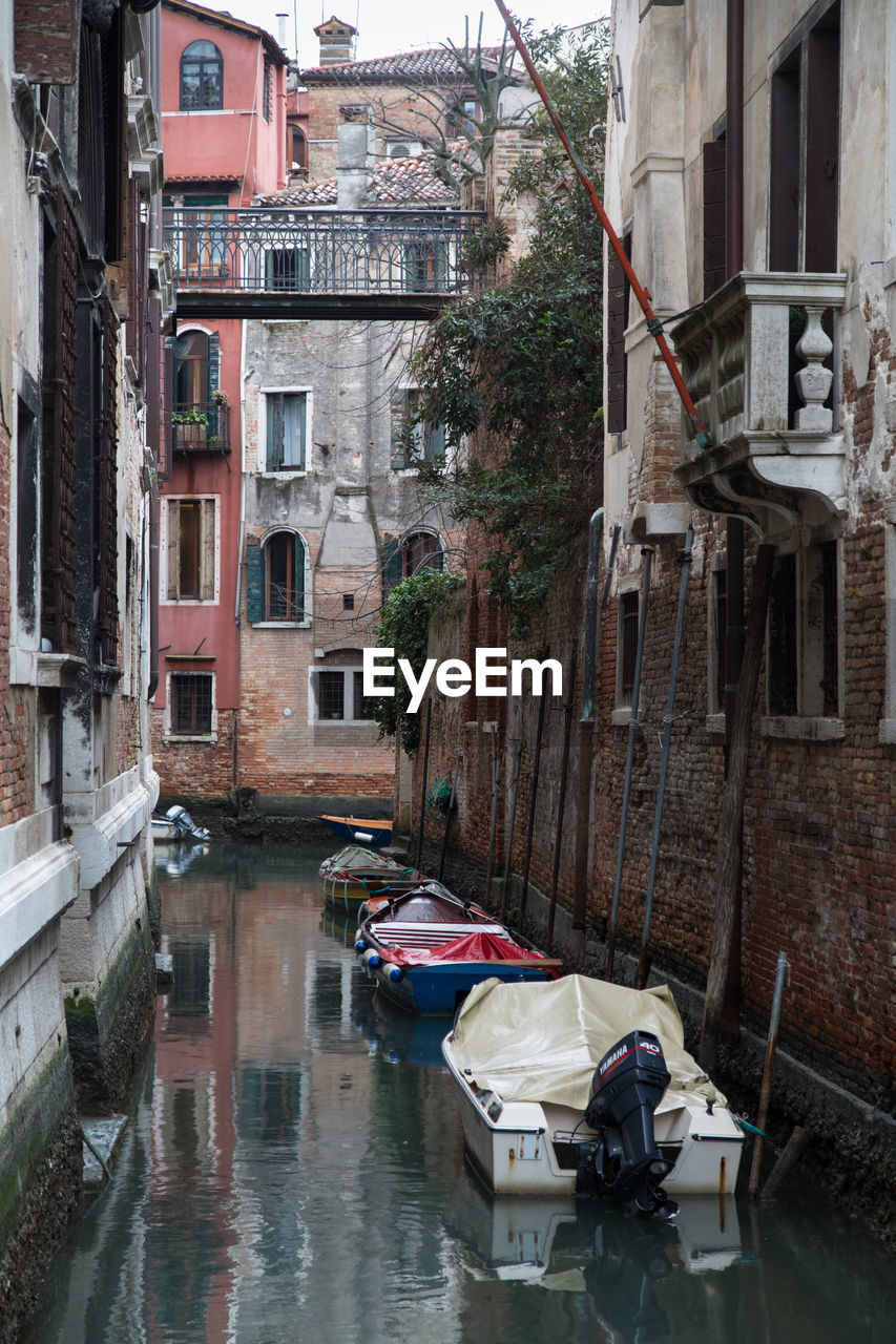 architecture, building exterior, built structure, water, transportation, mode of transportation, nautical vessel, building, reflection, canal, city, residential district, waterfront, nature, day, moored, plant, no people, tree, outdoors