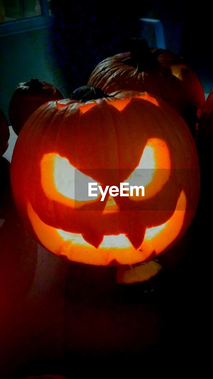 pumpkin, halloween, jack o lantern, celebration, anthropomorphic face, orange color, tradition, holiday - event, spooky, night, cultures, jack o' lantern, illuminated, no people, lantern, autumn, outdoors, close-up