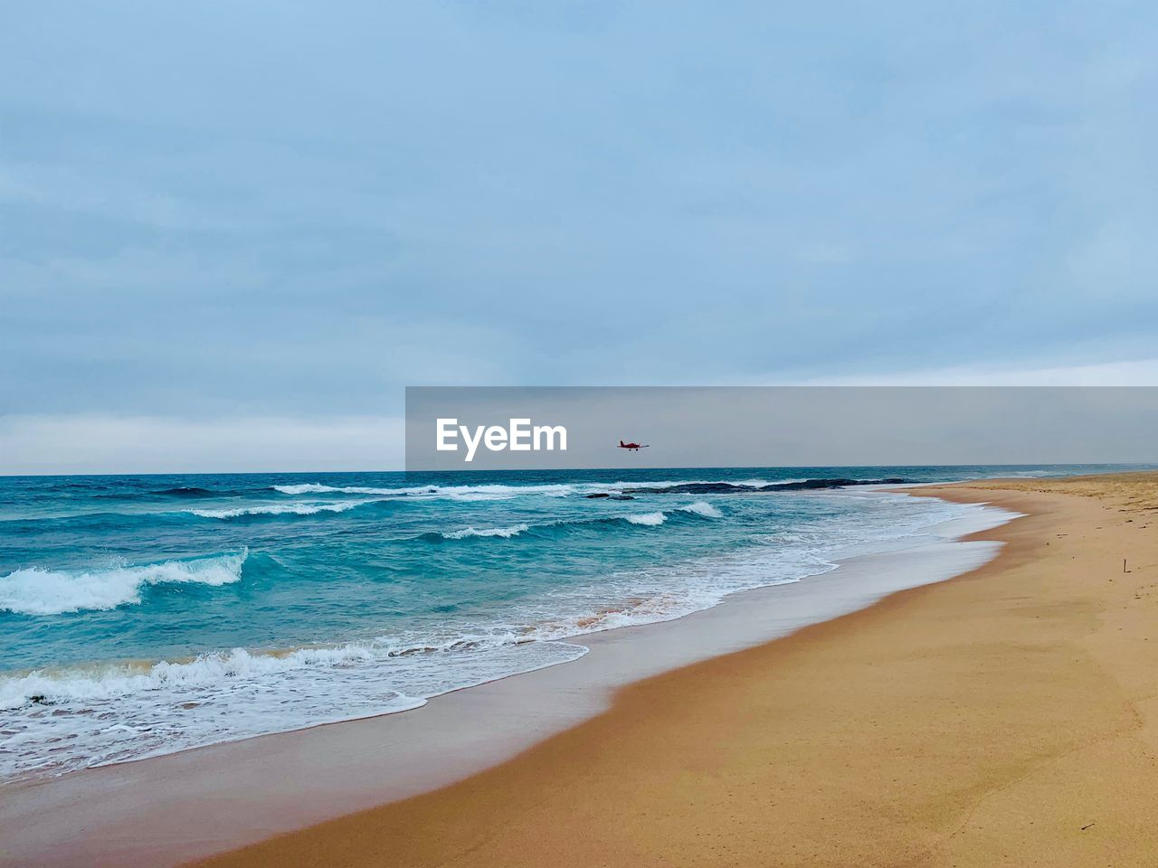 sea, beach, water, land, sky, scenics - nature, horizon over water, horizon, beauty in nature, motion, wave, cloud - sky, tranquility, tranquil scene, nature, day, aquatic sport, sand, idyllic, no people, outdoors