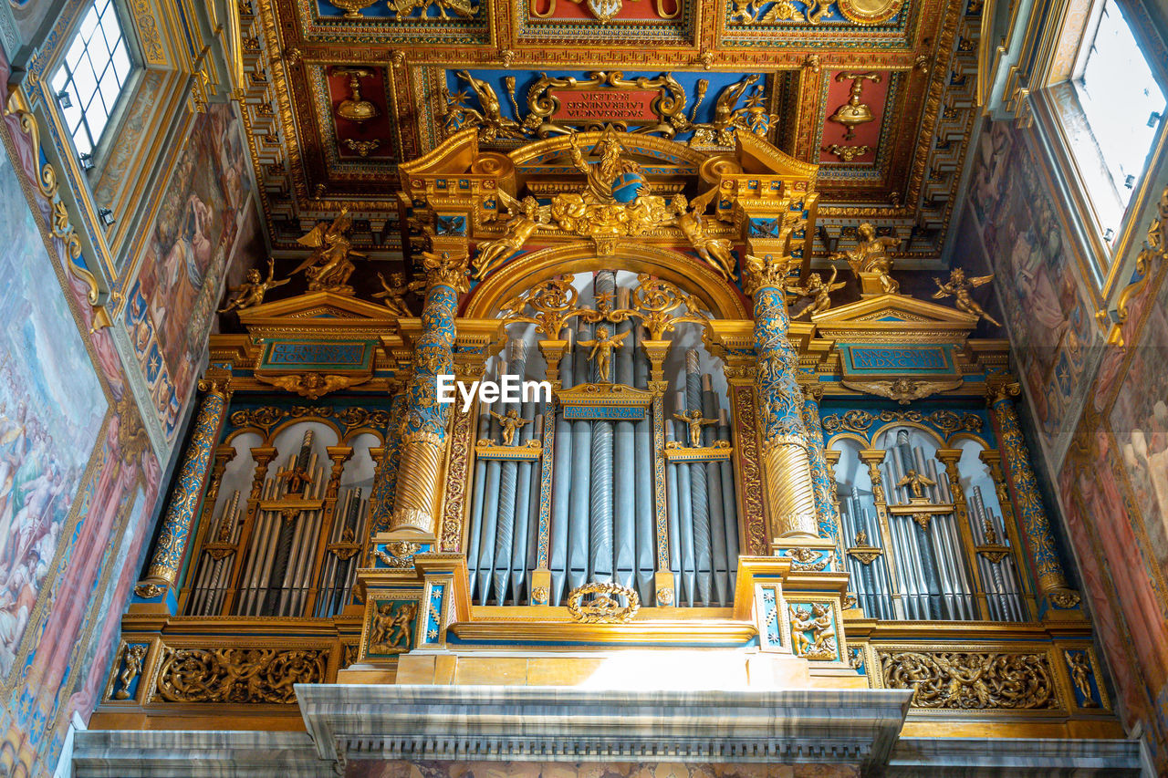 religion, belief, architecture, place of worship, built structure, spirituality, building, music, musical instrument, pipe organ, no people, building exterior, the past, history, gold colored, ornate, altar