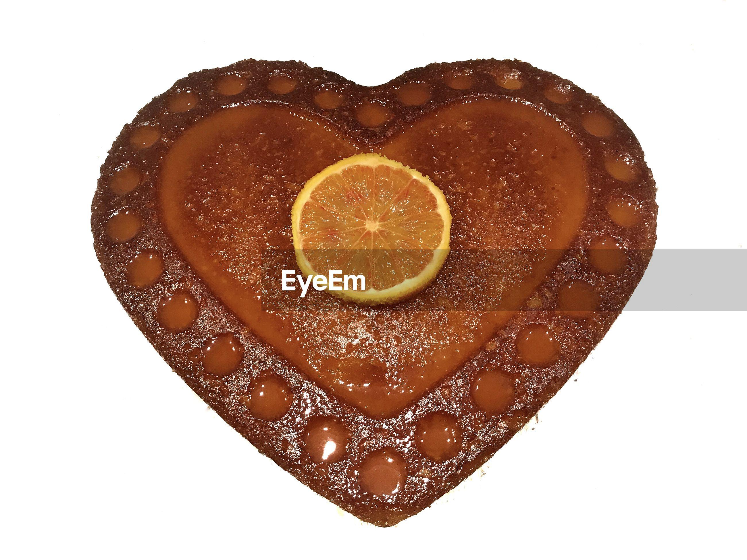 Directly above shot of orange slice against white background
