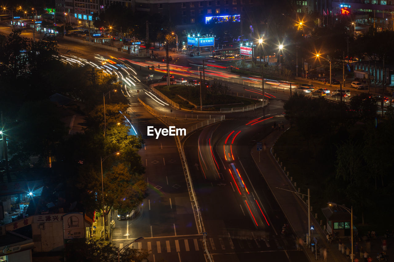 night, illuminated, light trail, high angle view, transportation, motion, building exterior, speed, long exposure, street, architecture, city, road, no people, outdoors, high street, built structure