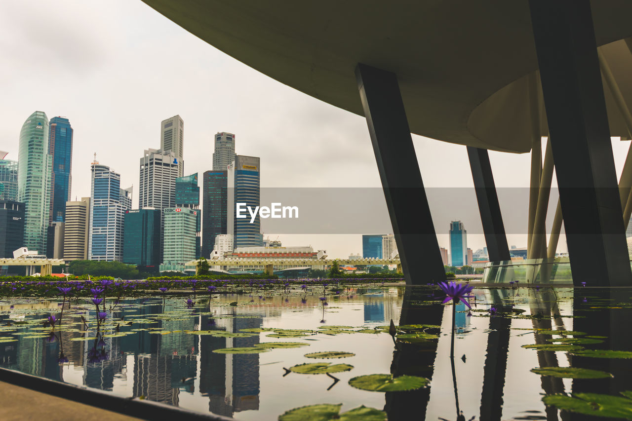 built structure, architecture, building exterior, city, water, sky, building, office building exterior, reflection, nature, no people, skyscraper, cityscape, modern, waterfront, day, tower, tall - high, urban skyline, outdoors, financial district, luxury