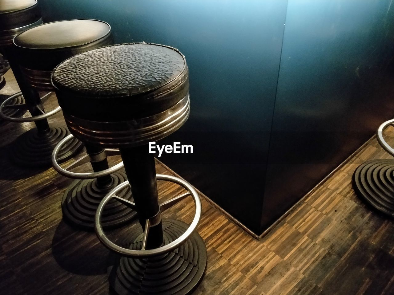 High Angle View Of Empty Seats On Hardwood Floor At Bar