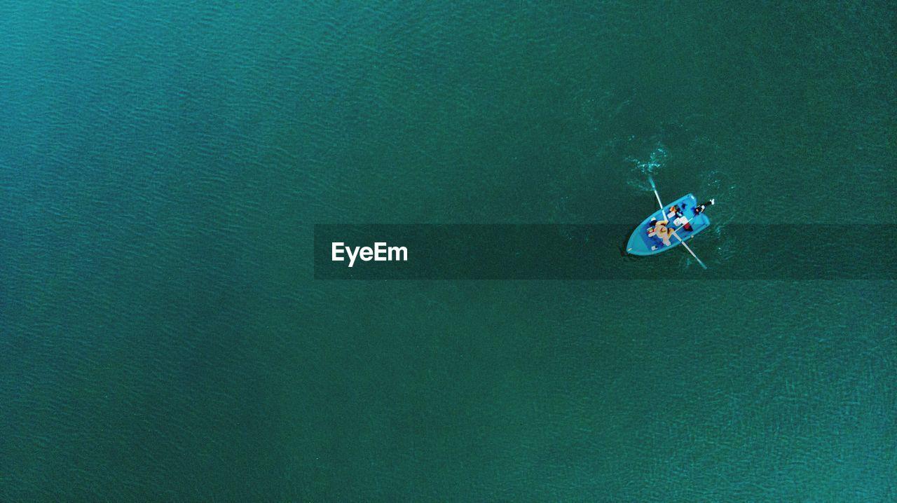 High Angle View Of Man In Rowboat At Sea