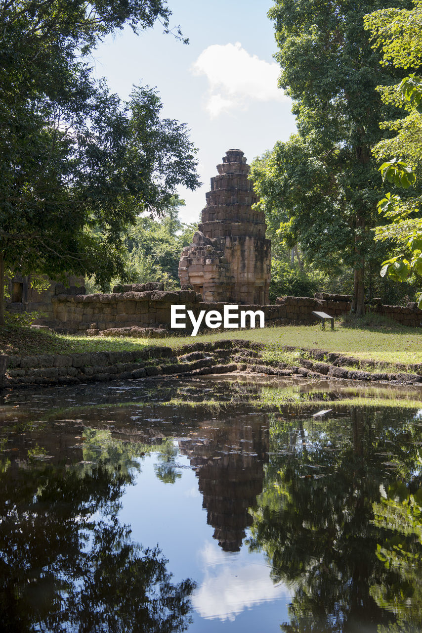 reflection, tree, old ruin, history, built structure, water, day, sky, ancient civilization, outdoors, architecture, ancient, no people, nature, travel destinations, building exterior, beauty in nature