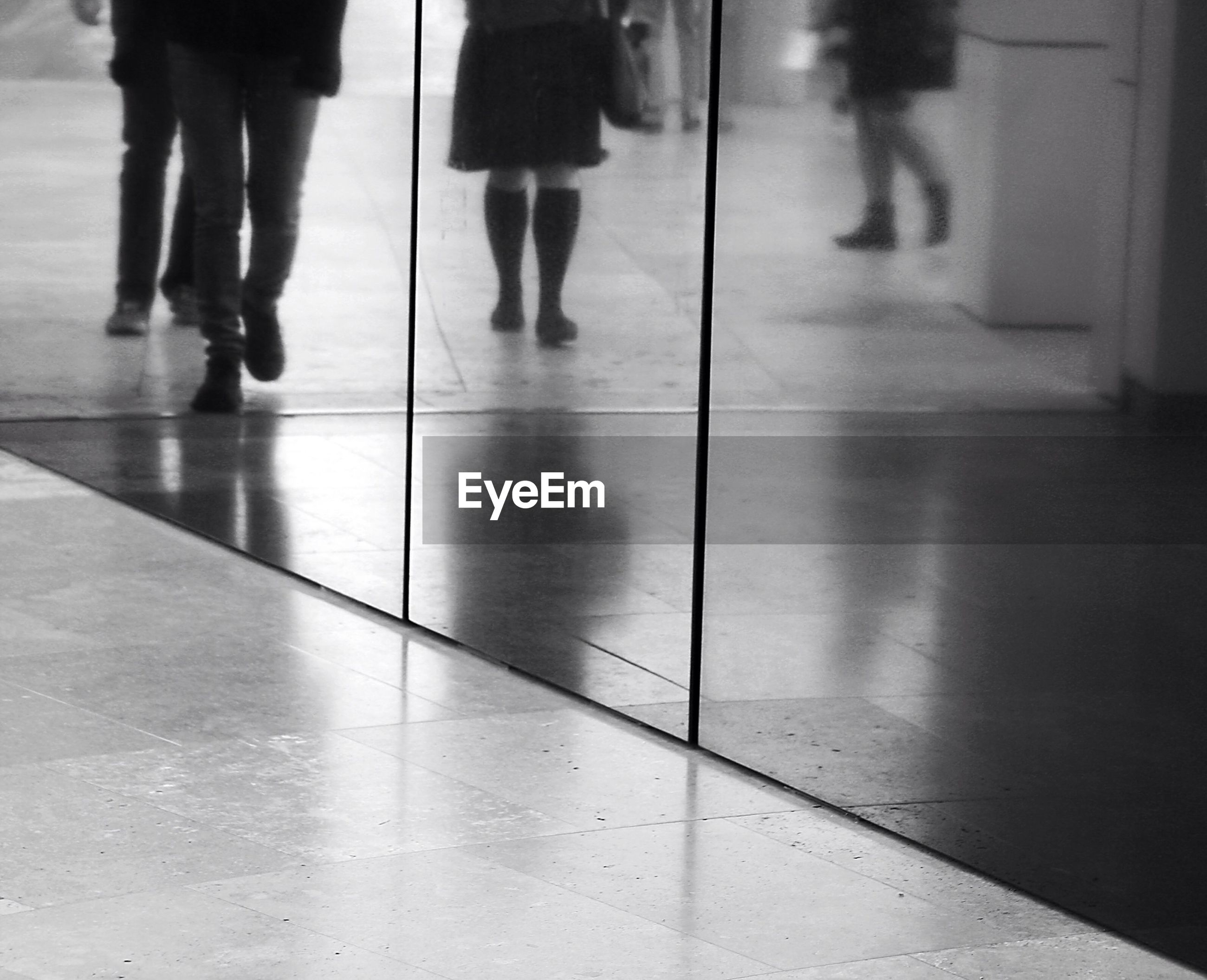 Reflection of people on glass