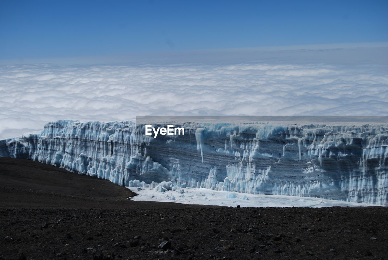 Scenic View Of Glacier Against Sky During Winter