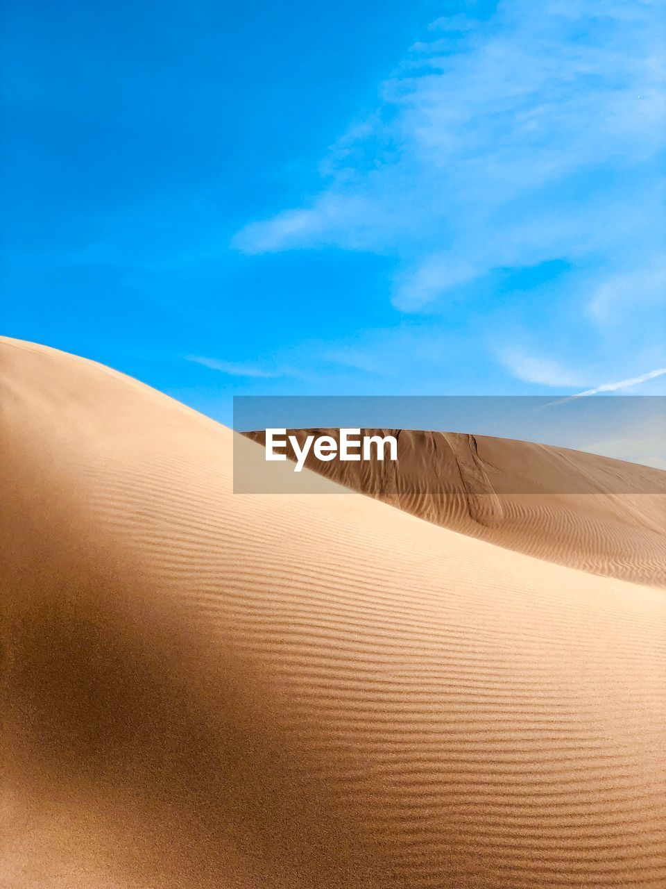 scenics - nature, sand, desert, land, sand dune, arid climate, climate, beauty in nature, landscape, tranquil scene, sky, tranquility, blue, nature, non-urban scene, environment, sunlight, day, remote, cloud - sky, no people, outdoors